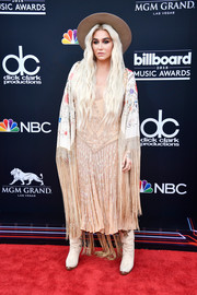 Kesha topped off her dress with a fringed floral shawl.