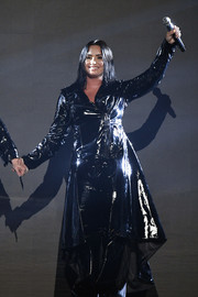 Demi Lovato performed at the 2018 Billboard Music Awards rocking a black patent coat by Ashton Michael.