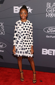 Skai Jackson completed her outfit with a pair of black slim-strap sandals.