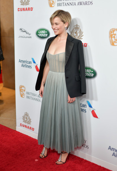 Emilia Clarke styled her look with a pair of bedazzled T-strap sandals by Christian Louboutin.
