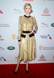 Elizabeth Debicki brightened up the red carpet with this gold sequined dress by Prada at the 2018 British Academy Britannia Awards.