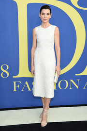 Julianna Margulies styled her dress with strappy white heels.