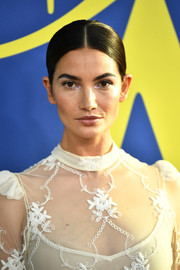Lily Aldridge kept it minimal with this slick center-parted ponytail at the 2018 CFDA Fashion Awards.