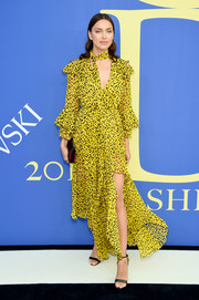 Irina Shayk went for a bohemian vibe in this flowy yellow leopard-print wrap dress by Diane von Furstenberg at the 2018 CFDA Fashion Awards.