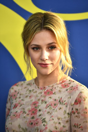 Lili Reinhart worked a messy center-parted updo at the 2018 CFDA Fashion Awards.