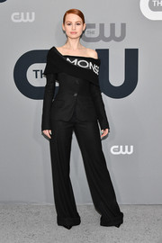 Madelaine Petsch looked hip in a black off-the-shoulder suit by Monse at the 2018 CW Network Upfront.