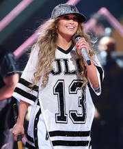 Jennifer Lopez rocked a glammed-up New York Yankees baseball cap at the 2018 DirecTV Now Super Saturday Night concert.