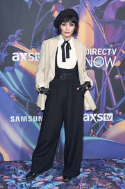 Vanessa Hudgens teamed black scoopneck overalls by Calvin Klein with a white tie-neck shirt for the 2018 DirecTV Now Super Saturday Night concert.