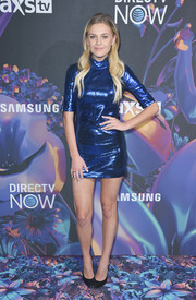 Kelsea Ballerini dazzled in a metallic blue mini dress by RtA at the 2018 DirecTV Now Super Saturday Night concert.