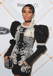 Janelle Monae carried an embellished zip-around clutch by Kate Spade when she attended the Essence Black Women in Hollywood Awards.