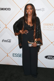 Estelle paired her sparkling jacket with black wide-leg pants.