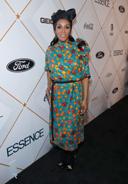 June Ambrose cut a lively figure in a colorful floral sequin dress by Marc Jacobs at the Essence Black Women in Hollywood Awards.