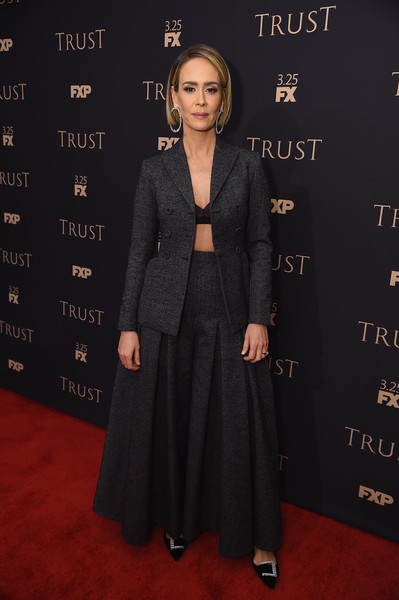 Sarah Paulson styled her suit with bejeweled black pumps by Manolo Blahnik.