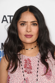 Salma Hayek attended the 2018 Film Independent Spirit Awards nominees brunch wearing her hair in boho waves.