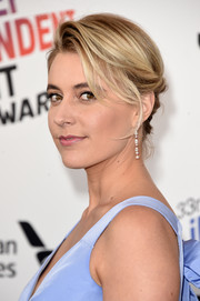 Greta Gerwig styled her hair into a twisty updo for the 2018 Film Independent Spirit Awards.