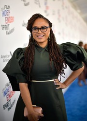 Ava DuVernay paired a pink satin clutch by Jimmy Choo with a green puff-sleeved dress for the 2018 Film Independent Spirit Awards.