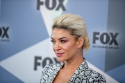 Jessica Szohr rocked a platinum-blonde bun with dark roots at the 2018 Fox Network Upfront.