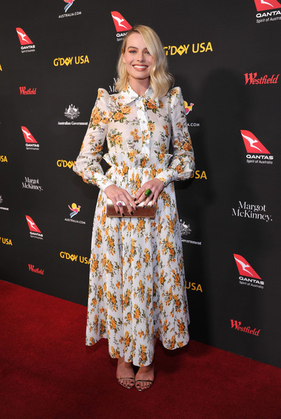 Gold slim-strap sandals by Jimmy Choo finished off Margot Robbie's outfit.