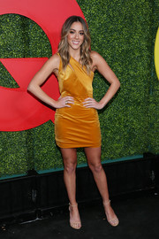 Chloe Bennet chose a mustard one-shoulder mini dress by Haney for the 2018 GQ Men of the Year party.