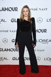 Alicia Silverstone looked groovy in a black bell-bottom jumpsuit with a sparkling bodice at the 2018 Glamour Women of the Year Awards.