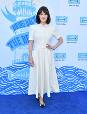 Zooey Deschanel styled her dress with a pair of black-and-white ballet flats.