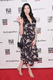 Laura Prepon paired her dress with a quilted black shoulder bag by Saint Laurent.