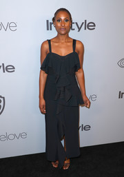 Issa Rae channeled summer in a black Proenza Schouler maxi dress with thin straps and ruffle detailing at the Warner Bros. and InStyle Golden Globes after-party.
