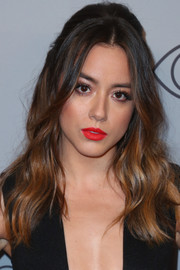 Chloe Bennet lit up her pretty face with a swipe of bright red lipstick.