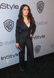 Salma Hayek worked a masculine-chic vibe in a tux-inspired black jumpsuit at the Warner Bros. and InStyle Golden Globes after-party.