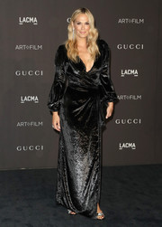 Molly Sims donned a shimmering black wrap gown by Maria Lucia Hohan for the 2018 LACMA Art + Film Gala.