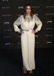 Paris Jackson went for funky styling with a pair of bejeweled sneakers, also by Gucci.