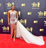 Tiffany Haddish got majorly glam in a Galia Lahav strapless column dress with a high slit and a long train for the 2018 MTV Movie & TV Awards.