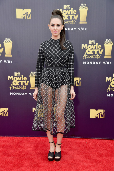 Alison Brie styled her frock with chunky black platforms by Sophia Webster.