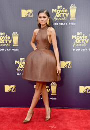 Zendaya Coleman grabbed stares in a brown August Getty Atelier halter dress with an exaggeratedly flared skirt at the 2018 MTV Movie & TV Awards.