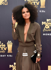 Zazie Beetz paired a black velvet clutch with a plunging brown dress for the 2018 MTV Movie & TV Awards.