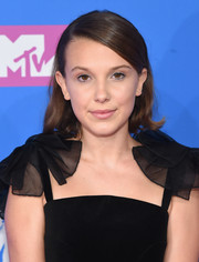 Millie Bobby Brown wore a short side-parted hairstyle with wavy ends at the 2018 MTV VMAs.