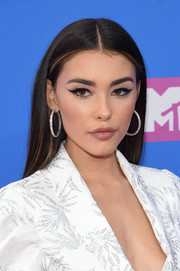 Madison Beer polished off her look with a pair of elegant diamond hoops.