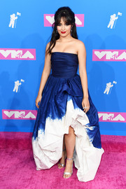 Camila Cabello styled her dress with silver ankle-strap sandals.