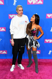 Ariana Grande looked every bit the pop star in a silver latex bustier by Venus Prototype at the 2018 MTV VMAs.