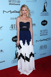 Anna Camp kept it fun yet stylish in a strapless cutout gown by Self-Portrait at the 2018 Make-Up Artists & Hair Stylists Guild Awards.
