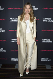 Jessica Biel polished off her look with a pair of champagne silk trousers, also by The Row.