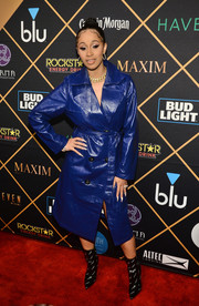 Cardi B hit the 2018 Maxim Party looking fierce in a cobalt leather coat.