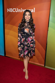 Auli'i Cravalho paired her dress with basic nude sandals by Steve Madden.