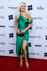Malin Akerman paired her dress with black ankle-strap sandals.