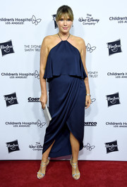 Daisy Fuentes teamed her frock with silver T-strap sandals.