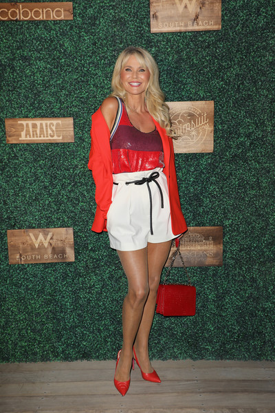 Christie Brinkley topped off her outfit with a bright red blazer.
