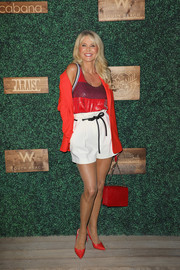 For her footwear, Christie Brinkley chose a pair of red slingback pumps.