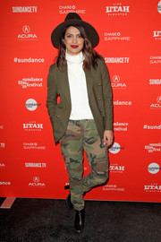 Priyanka Chopra layered an olive-green blazer over a white turtleneck for the Sundance premiere of 'Burden the Park.'