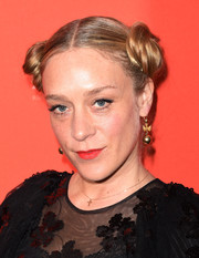 Chloe Sevigny accessorized with a pair of dangling gold spheres.