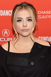 Chloe Grace Moretz wore a black satin headband for added sweetness.